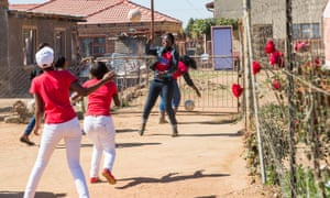 Rise Club members play football after a group meeting. Temba, South Africa