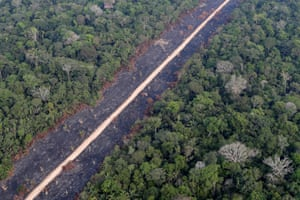 A road runs through a tract of burnt Amazon jungle near Porto Velho, Rondonia State, Brazil, August 14, 2020.