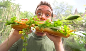 A twenty-something white male attacks an enormous veggie meal