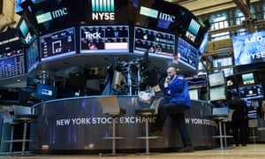 A trader works at his desk on the floor of the New York Stock Exchange today.