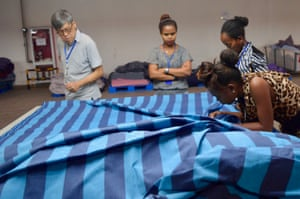 Peter Wan, from the Chinese company Wuxi Jinmao, inspects fabrics at Hawassa Industrial Park.