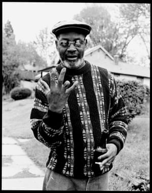 """OG Nub, East St. Louis, Missouri, 2003  (from series Bloods)OG Nub is an old school guy and is a respected man in the Blood neighbourhood of East St. Louis. We were introduced by my friend who thought I should photograph Nub, but Nub's view was, """"I don't know you, and I don't know what you're really here for."""" He went on, """"If you want to photograph these younger guys, then that's fine, but I don't want you to photograph me."""" On my last day he came over and said to me, """"I've been watching you and what you're doing, and I think you're alright. I want to be a part of part of your book"""". Raising his four-fingered right hand, he said with a smile, """"I'll show ya five up five and give ya four"""""""