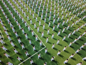 Zhejiang, China Students and teachers compete in a Baduanjin qigong contest, one of the most common forms of qigong used as exercise, at a primary school