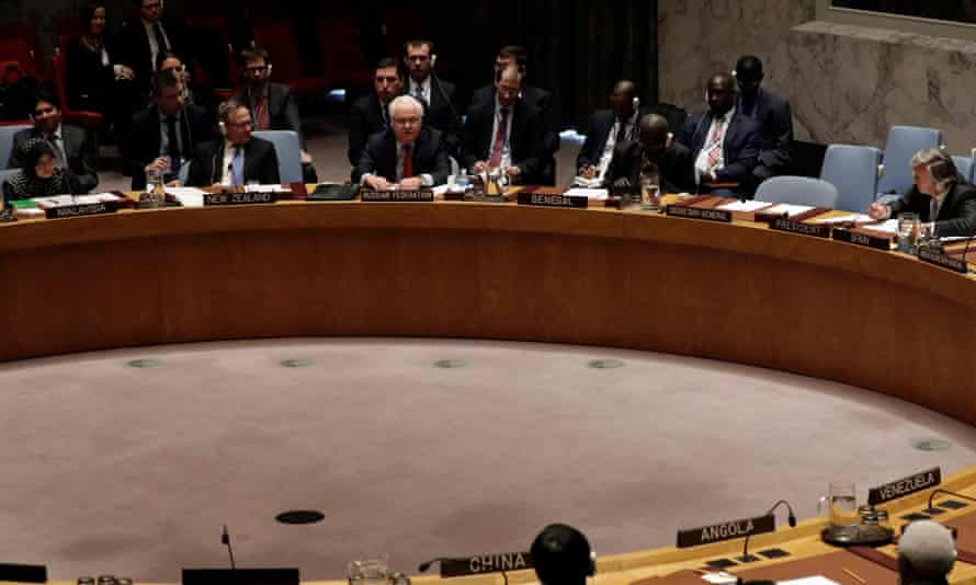 Russian ambassador to the UN Vitaly Churkin (top, centre) addresses the security council