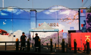 Security guards stand at the gates of what is officially known as a vocational skills education centre in Huocheng County in Xinjiang.