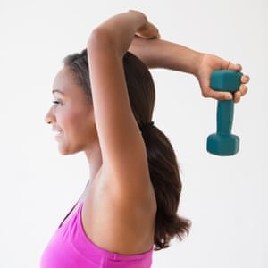 Black woman lifting weights