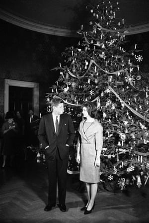 1961- President John F. Kennedy and Jacqueline Kennedy pose in front of the Christmas tree in the Blue Room of the White House.