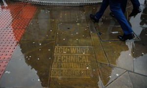 A recruitment ad for the British intelligence service GCHQ on the pavement in Shoreditch, east London.