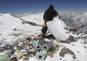A Nepalese sherpa collects rubbish left by climbers at an altitude of 8,000 metres during an Everest clean-up expedition.