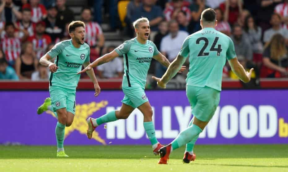 Leandro Trossard celebrates scoring Brighton's late goal at Brentford.