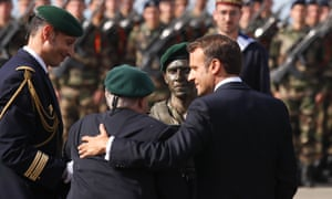 French President Emmanuel Macron, right, hugs French war veteran Leon Gautier a ceremony to pay homage to the Kieffer commando, Thursday, June 6, 2019 in Colleville-Montgomery, Normandy. T