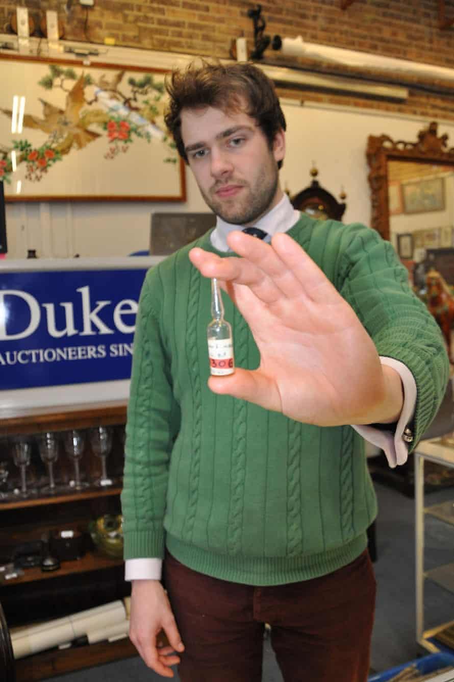Timothy Medhurst of Duke's auction house with a phial of Winston Churchill's blood