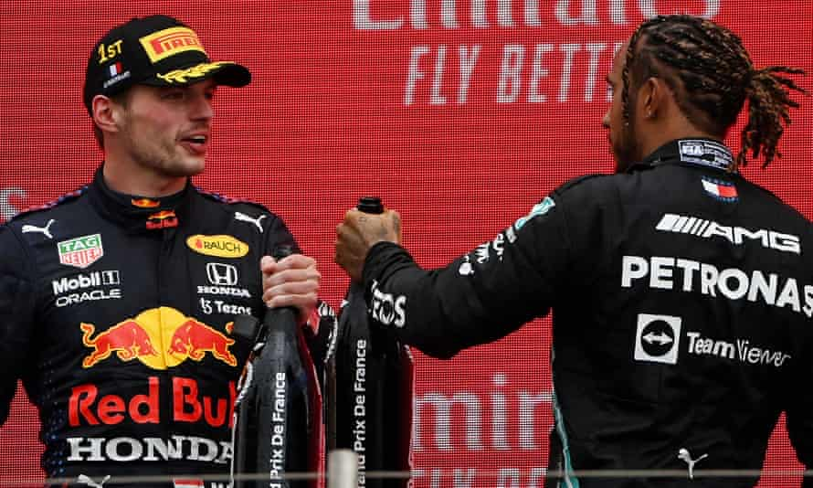 Max Verstappen and Mercedes's Lewis Hamilton celebrate on the podium after the Red Bull driver's victory in the French Grand Prix.