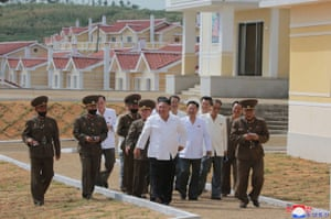 Kangbuk-ri, North Korea: Leader Kim Jong Un, centre, visits Kumchon county after to view restoration work following recent flood damage