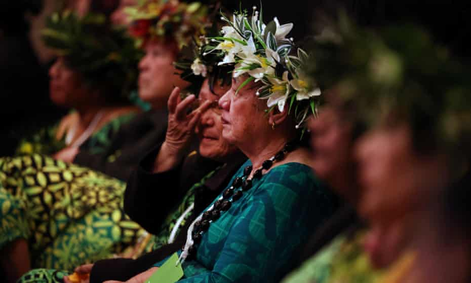 Guests listen as New Zealand prime minister Jacinda Ardern makes a formal apology in Auckland to the Pacifika people affected by the dawn raids of the 1970s