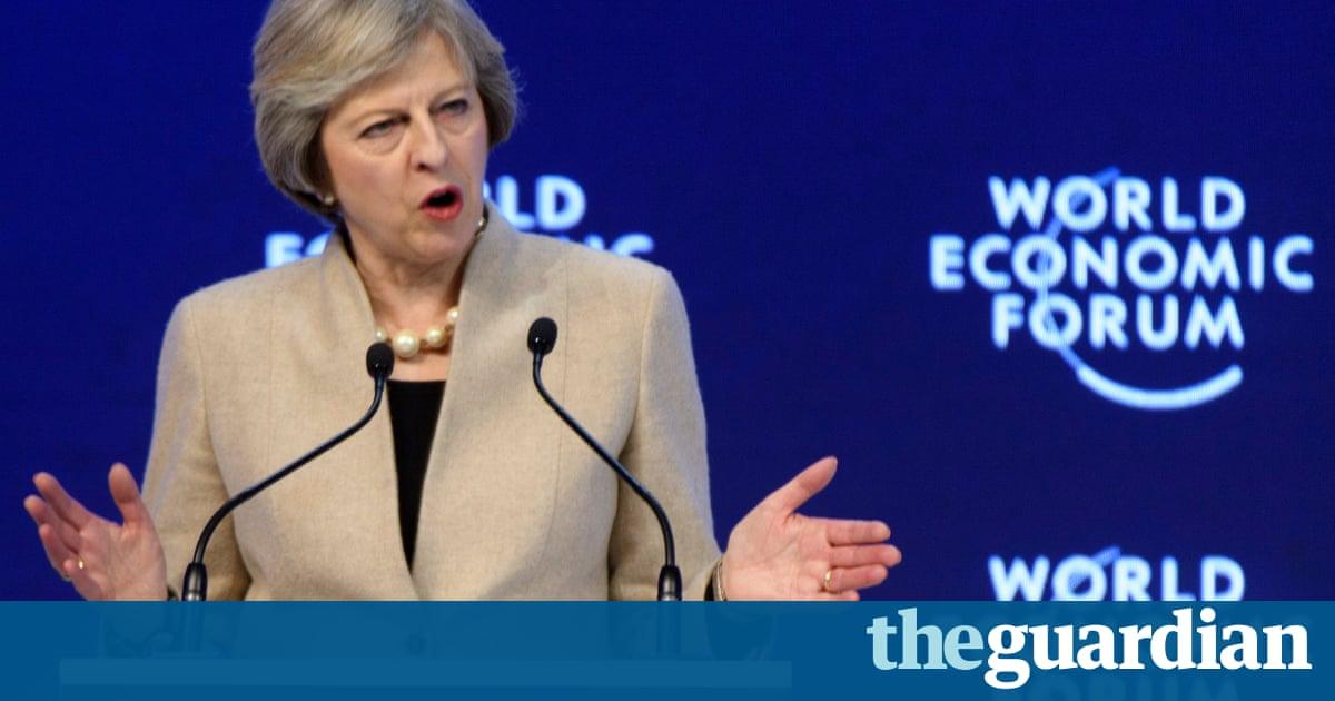 Companies must share benefits of globalisation, Theresa May tells Davos