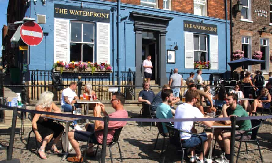 People eat outside at a restaurant in Yorkshire as part of the Treasury's 'eat out to help out' scheme in August