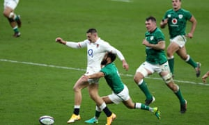 Jonny May kicks the ball through to score to score his second try against Ireland at the end of a run that begin deep in England's half