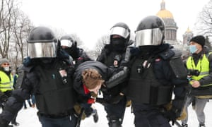 Riot police officers carry a detained protester out of Senate Square, Moscow