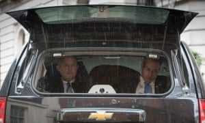 Members of the President's security team sit in the back of a car at Downing Street on April 22, 2016 in London, England.