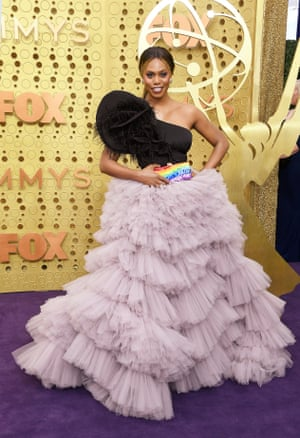 Actor Laverne Cox attends the Emmy Awards carrying a bag that bears the date of the first supreme court case on the civil rights of transgender people.