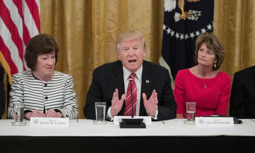 Susan Collins, left, and Lisa Murkowski flank Donald Trump at a White House meeting last year.