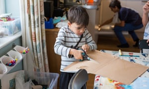 Zephan, four, makes a cardboard model