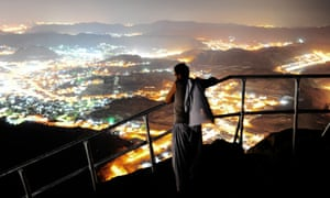 mecca lit up at night seen from jabal al nour