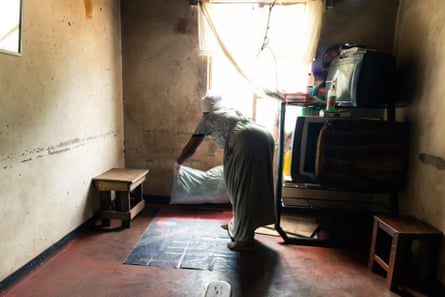 An untrained midwife, whose house has served as a makeshift maternity ward