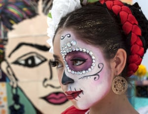 US: Mary Triana, 16, dresses up for the Viva la Vida festival in Santa Ana, California. Families bring offerings to makeshift altars at the city's train station
