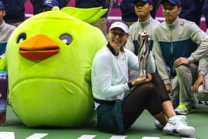 Maria Sharapova celebrates after winning the Tianjin Open tennis tournament