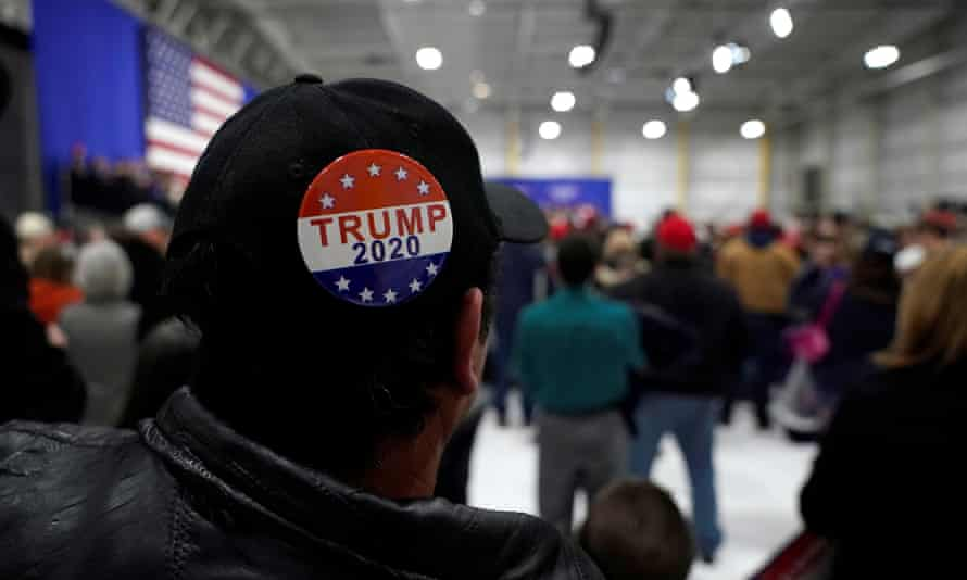 A man wears a Trump 2020 campaign button at a Make America Great Again rally in Pennsylvania.