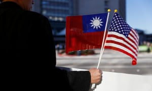 A demonstrator holds flags of Taiwan and the United States in support of Taiwanese President Tsai Ing-wen during her stopover in California.