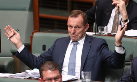 Tony Abbott reacts when the prime minister talks about 'ideology and idiocy [taking] charge of energy policy' during question time.