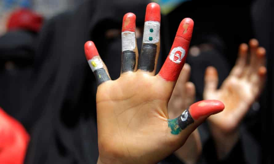 A girl's fingers painted with the flags of Egypt, Yemen Syria, Tunisia and Libya during a demonstration in Taiz, Yemen, in June 2011.