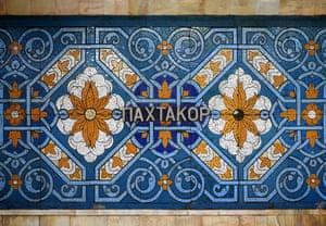 A mosaic of freshly puffed cotton bolls inside Pakhtakor station