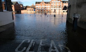 Water spills over the banks of the River Ouse in York on Sunday.
