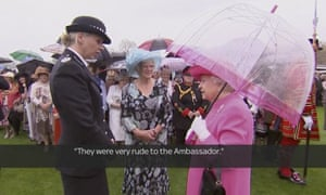 Queen Elizabeth speaks to Metropolitan police commander Lucy D'Orsi in the garden of Buckingham Palace