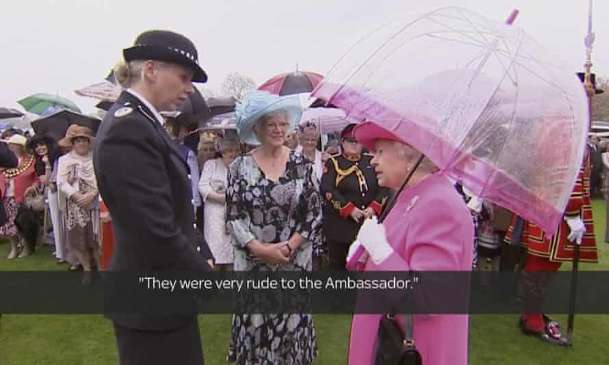 In image made from pool video, Queen Elizabeth II speaks with Metropolitan police commander Lucy D'Orsi in the garden of Buckingham Palace.