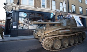 BrewDog staff drive a tank through central London.
