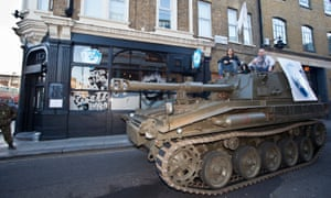 Dickie and Watt drive a tank through Camden in north London