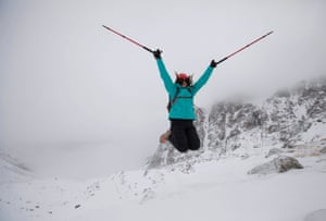A tourist jumps for a picture during a hike towards the glacier