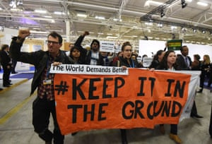 Activists hold a banner reading 'Keep it in the ground' in Le Bourget