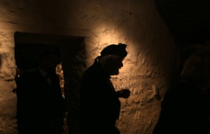 A guest attends the first Burns supper to be held in Burns' Alloway cottage in more than two centuries