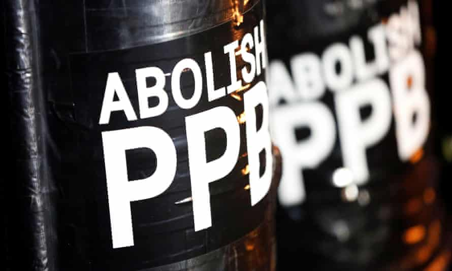 A sign reading 'Abolish PPB' is seen on shields held by demonstrators during a protest against police violence and racial injustice in Portland, Oregon, at the weekend.