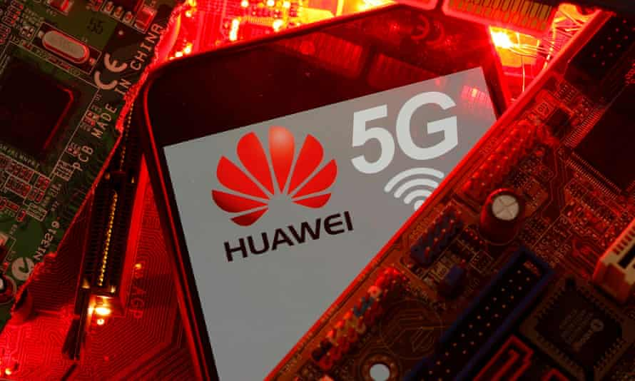 A smartphone with the Huawei logo among some PC motherboards