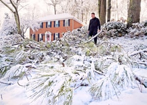Kennesaw, GAA local man surveys the damage to broken limbs from pine trees after a heavy snow fall. The frigid temperatures behind a cold front combined with moisture off the Gulf of Mexico to bring unusual wintry weather to parts of the South.