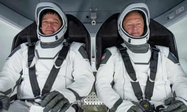 Doug Loverro has resigned from Nasa just over a week before astronauts Bob Behnken (L) and Doug Hurley (R) are due to head on a mission to the International Space Station.