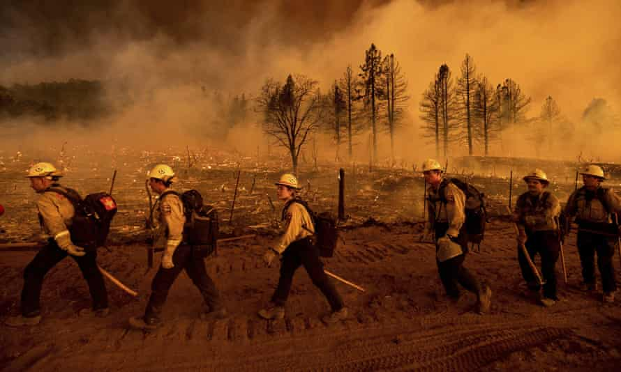 Firefighters in California battle the Sugar Fire in Doyle on 9 July 2021.