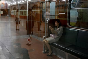 A woman sits in a train at a subway station in Pyongyang.
